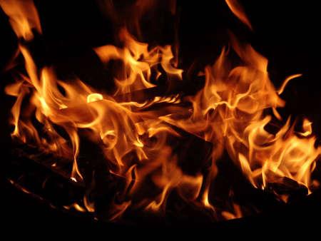 Vivid fire in dark Stock Photo