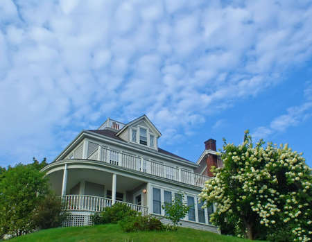 Real Estate: Detached House on the hill in blooming garden.