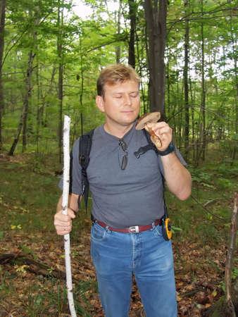 Mushroomer in Fall Forest 免版税图像