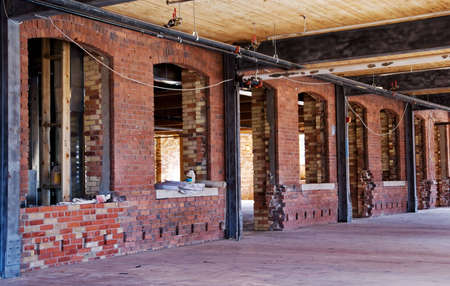 site: Old brick wall. Construction site. Renovation.
