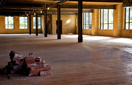 Old brick building is under renovation for modern office spaces. Downtown Toronto. Stock Photo