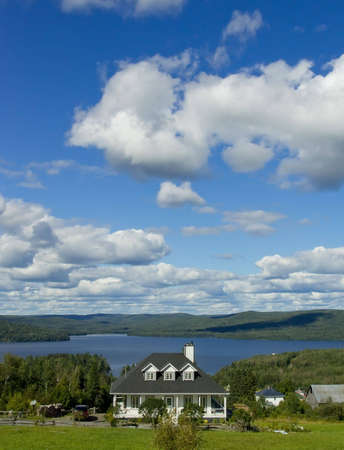 Real Estate: Detached House on the lake. New Brunswick, Canada. Vertical picture. 스톡 콘텐츠