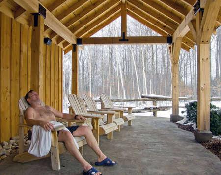 Man relaxing outdoor in spa. Winter, snow.