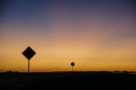colorful sunset with traffic signs