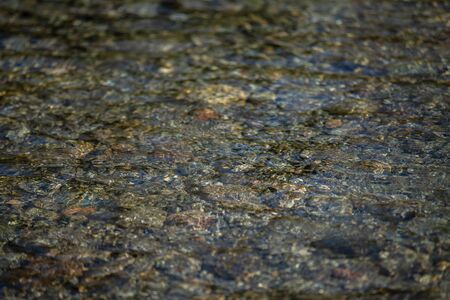 River pebbles under water. Texture Stock Photo