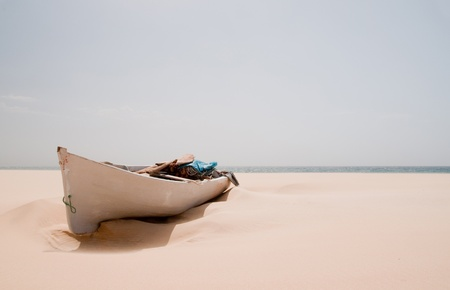cape verde: Old boat on the sandy beach of Santa Monica in Boa Vista in Cape Verde