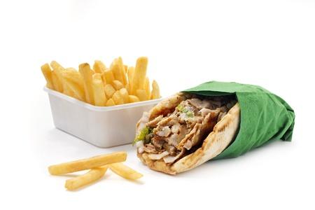 pita: kebab sandwich with chips Stock Photo