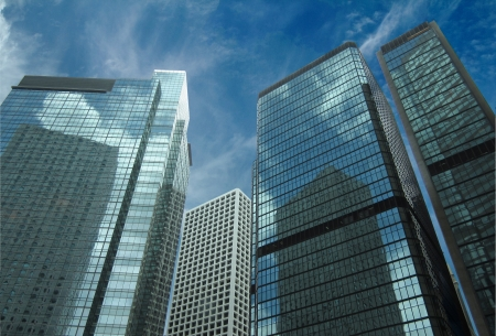 property development: view from the bottom of skyscrapers with blue sky Stock Photo
