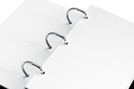 close up of open notebook with blank pages photo