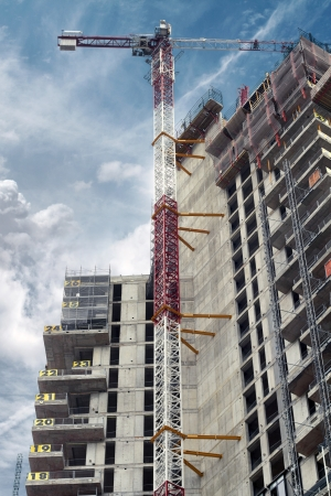 construction site with crane and block of flats photo