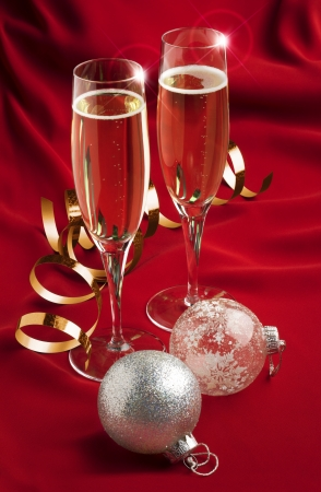 a pair of champagne glasses with christmas decorations photo