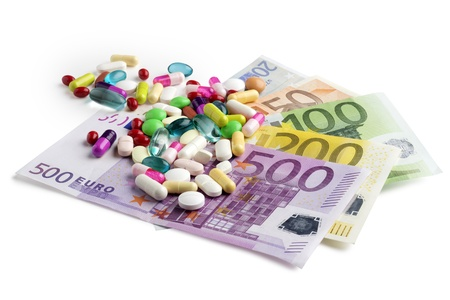 euro banknotes with colorful medicines on white background Stock Photo - 15913634