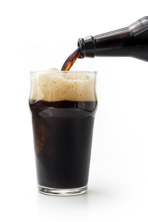 close up of dark beer poured from the bottle photo