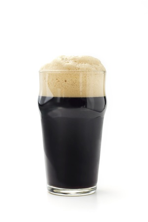 pint glass: pint of dark beer isolated on white background Stock Photo