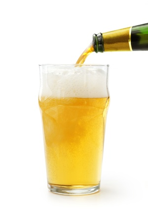 lager beer poured into a glass on white background photo