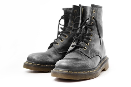 rubber sole: close up of black boots on white background Stock Photo