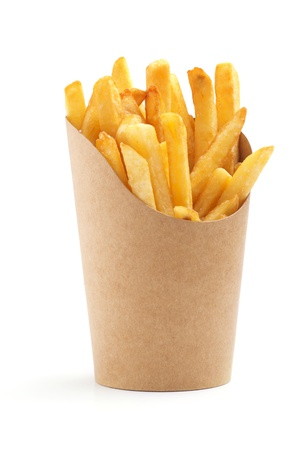 crispy: french fries in a paper wrapper on white background