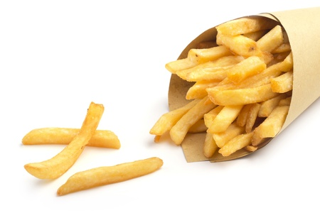 close up of paper cone with fries on white background