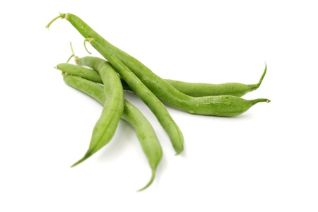 close up of green beans on white background photo