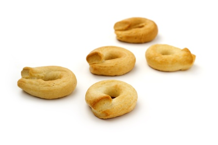 close up of ring-shaped biscuits on white background photo