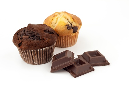 muffins: black and white chocolate muffin with three pieces of dark chocolate