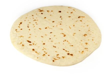 taco tortilla: close up of a piadina isolated on white background Stock Photo