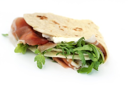 nosh: close up of italian typical sandwich with ham on white background