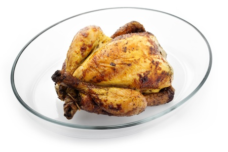 roasted chicken in baking dish on white background photo