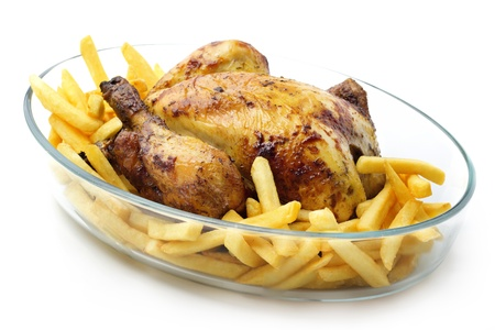 roasted chicken with french fries in oven dish photo