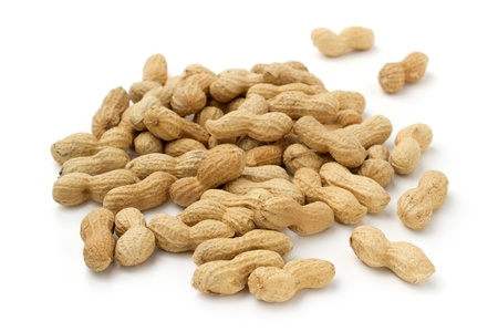 close up of pile of peanuts on white background photo