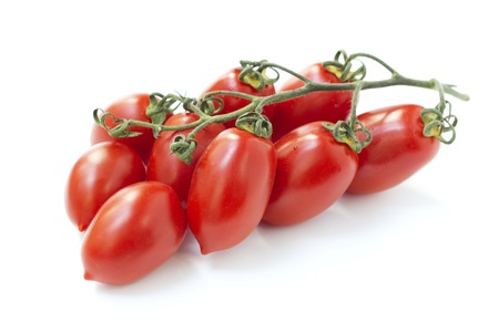 clusters: bunch of red tomatoes isolated on white background Stock Photo