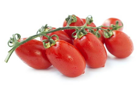 fresh bunch of red tomatoes on white background photo