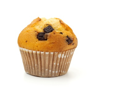 muffin with chocolate chips isolated on white background photo