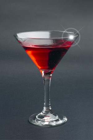 red cocktail isolated on black background photo