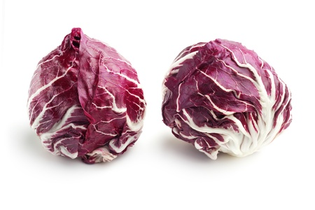pair of fresh radicchio isolated on white background photo