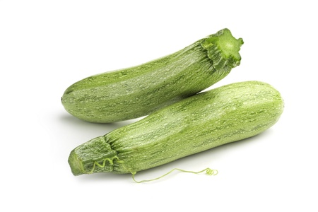marrow squash: two light green zucchini on white background
