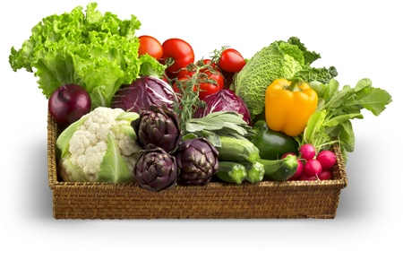 savoy cabbage: wicker basket of fresh vegetables isolated on white background