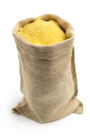 canvas bag with cornmeal isolated on white background photo