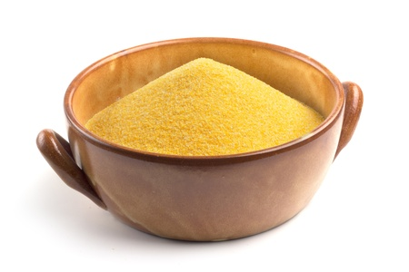 cornmeal in bowl isolated on white background Stock Photo - 16843972