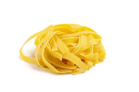 pasta tagliatelle isolated on white background photo