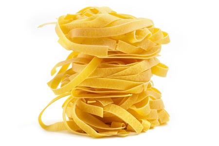 pile of tagliatelle isolated on white background photo
