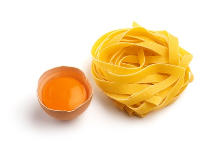 italian pasta and half egg on white background photo