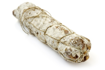italian salami: close up of a typical italian salami on white background