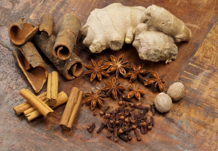 selection of spices on wooden background photo