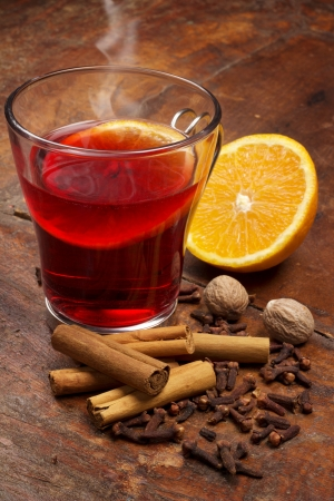 steaming glass of mulled wine and spices photo