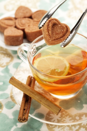 tongs with heart shaped sugar cube over a cup of tea Stock Photo - 17695339