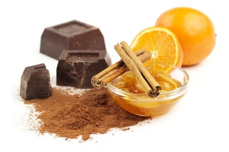 marmalade, cinnamon and chocolate on white background Stock Photo - 18384200