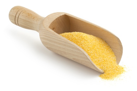 polenta: wooden scoop with cornmeal on white background Stock Photo