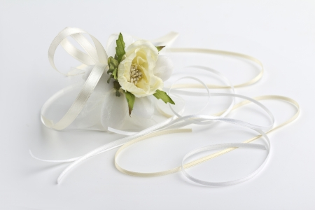 favor: wedding favor and satin ribbons  on white background Stock Photo