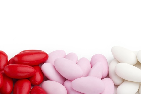 sugared: assortment of sugared almonds on white background